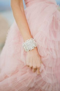 Make a glamorous statement on your wedding day with this stunning bridal…