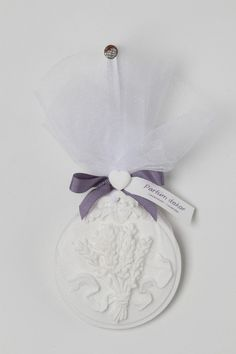 Hand Crafted Lavender Clay Flowers with Gorgeous detail of lavender, white mesh with purple ribbon.