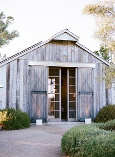 good way to conceal a remodeled barn... glass doors behind weathered barn doors