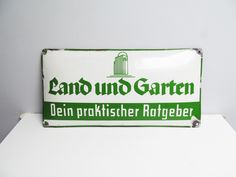 Vintage German Enamel advertising metal sign, Germany  Land and Garden Practical Guide Land und Garten green on white enamel Dold by EbyVintage on Etsy