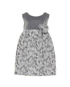 Παιδικό φόρεμα empire σε ποιότητα βελούδο ελαστικό, συνδυασμένο με jersey jacquard lurex, διακοσμημένο με μποτουνιέρα από δύχτι lurex.