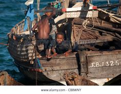 two-young-boys-playing-at-the-poop-of-a-dhow-lamu-kenya-CB8WNY.jpg (1300×1009)