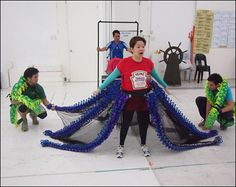 """Jinky and her evil eel helpers Felix Rivera (Flotsam) and Jaime Barcelon (Jetsam) getting ready for the tentacles' unveiling… - PHOTO EXCLUSIVE: """"Under the Sea"""" With the Cast of Manila's The Little Mermaid - Photo - Playbill.com"""