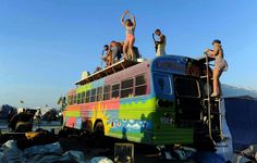 A band plays on top of a bus. (Andy Barron/The Reno Gazette-Journal)
