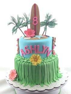 Hawaiian theme, sugar flowers, long surfboard, girl birthday cake