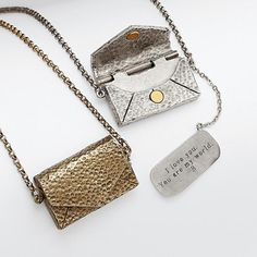 "A really good love letter begs to be carried around and read again and again. Our unique necklace lets her carry a loved one's message or initials right around her neck. The finely detailed envelope locket contains a small attached ""letter"" that may be personalized for an extra stylish love token."