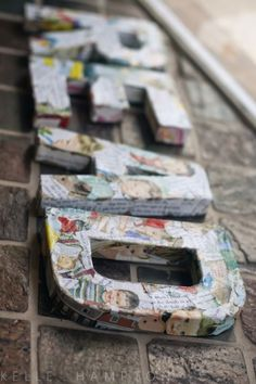 Cardboard letters decoupaged with pages of childrens books.