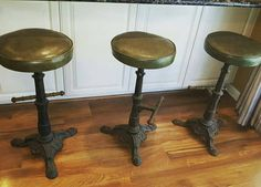 Check out this item in my Etsy shop https://www.etsy.com/listing/537769843/3-cast-iron-vintage-bar-stools