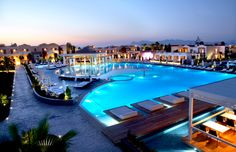 Pelagos Suites Hotel in Kos Island. Pelagos Suites Hotel is a beachfront hotel, spread in 39,000 m² in a quiet location on Lambi Beach, 2.5 km from the centre of Kos Town. It features 3 swimming pools, 2 tennis courts and a floating restaurant. KosExplorer.com -