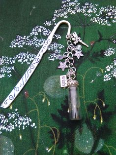 """Small fairy bookmark with real dandelion seeds in a glass bottle, ideal for """"End of term Teacher Presents."""