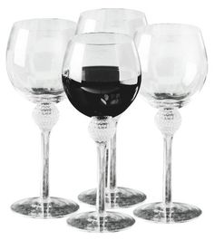 Golf Gifts & Gallery Clubhouse Collection Golf Ball Dimpled Wine Glasses by Golf Gifts & Gallery. $38.84. Golf Gifts & Gallery's Clubhouse Collection Golf Ball Dimpled Wine Glasses are a must for the bar of any golf enthusiast. This Set of 4 - 12oz wine glasses with golf ball dimpled bottom makes a great gift for the golfer that loves his/her wine. A classy way to show your true love of the game!