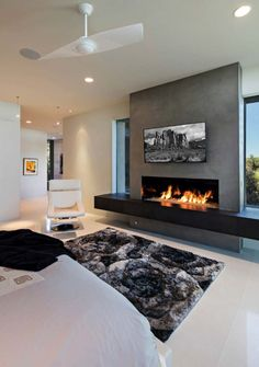 Dream home in the Arizona desert merges indoor/outdoor living - Thuisdecoratie Linear Fireplace, Home Fireplace, Modern Fireplace, Living Room With Fireplace, Fireplace Ideas, Modern Electric Fireplace, Stucco Fireplace, Stacked Stone Fireplaces, Fireplace Shelves