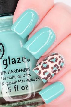 Light blue leopard nail design.