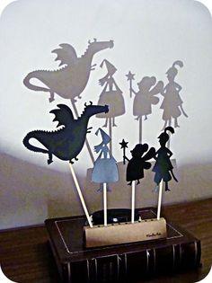 bedtime, flashlight, shadow puppet | black constrution paper, xacto knife, google images...fun