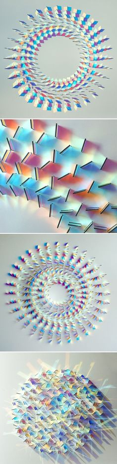 "These are glass wall panel installations by UK based artist Chris Wood. She says that her work is about expressing the ""magic of light"".:"