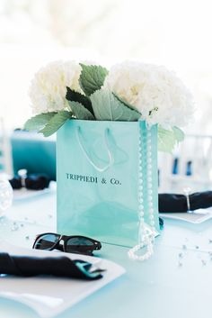 Tiffany OFF! a tiffany blue paper bag centerpiece with white hydrangeas and greenery pearls and sunglasses Tiffany Blue Cupcakes, Tiffany Blue Box, Tiffany Theme, Tiffany Party, Bridal Shower Treats, Bridal Shower Invitations, Bridal Showers, Tiffany's Bridal, Elegant Bridal Shower