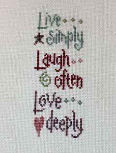 Live Simply, Laugh Often, Love Deeply    chart by Lizzie Kate    Lovely colors such as cadet, raspberry, and williamsburg blue, cross stitched