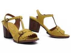 Almost preppy but with a bit of retro funk, these yellow Argila sandals are big fun! xo, Ped Shoes.