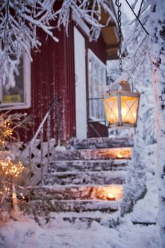 Traditional red wooden house in Finland. Winter time makes it look so cosy, right?