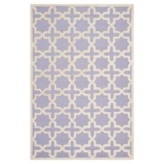 A lovely addition to your foyer, living room, or master suite, this hand-tufted wool rug showcases a quatrefoil motif in light blue.   P...