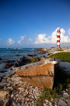 Lighthouse and rusty boat by Chepe Nicoli, via 500px