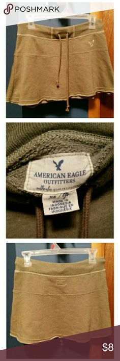 American Eagle mini skirt army green In excellent new condition. Ties at the waist. American Eagle Outfitters Skirts Mini