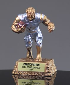 Show details for Monster Football Trophy Football Trophies, Going Crazy, How To Be Outgoing, Lion Sculpture, Animation, Statue, Boys, Movie Posters, Fun