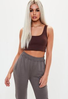 This bralet features a scooped neck, cotton fabric and brown hue.