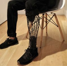 "The ""Exo-Prosthetic"" created by William Root, is a 3D printed artificial leg made from laser-sintered titanium, which uses a 3D scan of the wearer's truncated limb for fit, and a 3D scan of the intact limb for form..."