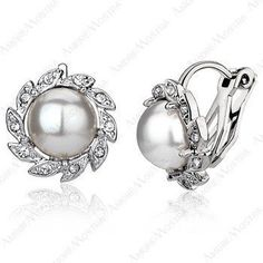Sunflower Pearl Clip Earring 18K Platinum Plated Austria Eleme Crystal. Earring Type:Clip Earrings   Material:Pearl   Metals Type:Platinum Plated   Shape\pattern:Plant   Pearl Type: Simulated-pearl   Jewelry Main Material:18K Platinum Plated   Main Stone:Austria Crystal   925 sterling silver Clip On earrings   Enjoy Domestic Delivery!It only takes 2 - 7 business days for the item to arrive.