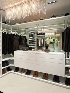 Dreamy, contemporary style closet with floating white chest of drawers, mirrored back, floating shelves and glass dropet pendant lighting!