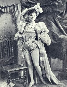 """Vesta Tilley as a """"principal boy"""" (the young male protagonist of a pantomime, traditionally played by a young actress in boy's clothes. The tradition grew out of laws restricting the use of child actors in London theatre, and the responsibility carried by such lead roles. A Breeches role was also a rare opportunity for an early 20th Century actress to wear a costume revealing the legs covered only in tights, potentially increasing the size of the audience.)"""