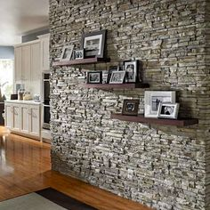 Nantucket Stacked Stone veneer is a dramatic backdrop for a family photo display. |  Photo: Courtesy of Eldorado Stone | thisoldhouse.com