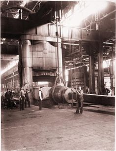 workers processing a 90-ton ingot using a 10,000-ton forging press at Carnegie Steel Company's Homestead Steel Works.