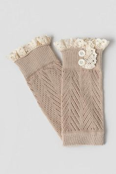 "The Teague Lace Boot Cuffs are the perfect accessory for a brisk fall day. These woven boot cuffs are finished with a lace edge detail and faux double button accent. Wear with tall boots and skinny jeans for a complete look.<br /> <br /> - 3.25"" length x 8.5"" height<br /> - Generous stretch<br /> - One size fits most<br /> - Imported"