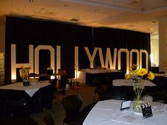 Giant Hollywood sign with black draping for a movie theme party in Worcester, MA, via Flickr.