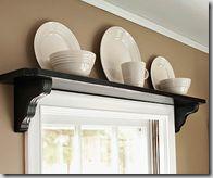 antique fan on shelf over door