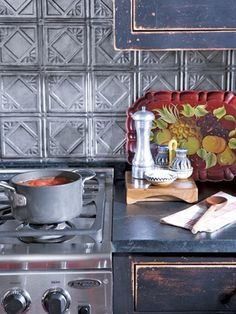 Pressed tin was painted with a faux finish for the backsplash in this country kitchen.