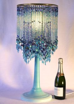 This lamp is also called Melinda.... it is a Melinda Lamp with fringed beads in hues of blue. $895.00, via Etsy.