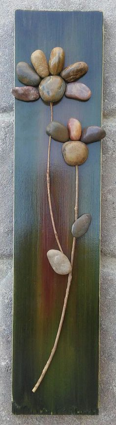 Check out this item in my Etsy shop https://www.etsy.com/listing/245964775/pebble-art-flowers-on-reclaimed-wood-155