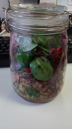 Salad in a jar: raw carrots, raw peas, cherry tomatoes, cucumber, tuna, tri-colour quinoa, spinach, beetroot, pomegranate pips. By Chantal