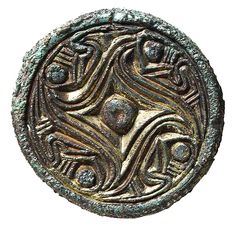 Bronze disk brooch. This brooch is from the Vendel period in Swedish history, which precedes the Viking age.