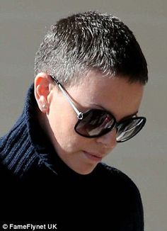 Salt and pepper: Charlize Theron shows off gray hair as she grabs lunch with a friend in West Hollywood, Los Angeles.