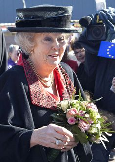 Queen Beatrix of the Netherlands attended the 50th anniversary of the European School in Bergen today. Beatrix repeated the black straw hat with patent leather band around the crown she wore in Brunei in January
