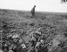 MINISTRY INFORMATION FIRST WORLD WAR OFFICIAL COLLECTION (Q 184) Troops of the 2nd Canterbury Battalion, New Zealand Division, rest in a shell hole, Battle of Flers-Courcelette, 15 September 1916.