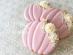 Pink pumpkin cookies with flowers.