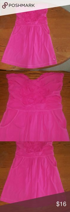 Abercrombie & Fitch dress Super cute Perfect condition pink strapless dress. Bunching on top with flowers. Elastic around waist. Has pockets. Great stretch. Size Medium. Abercrombie & Fitch Dresses Strapless