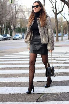 Leather mini skirt (+Wolford tights) Lady Addict en stylelovely.com