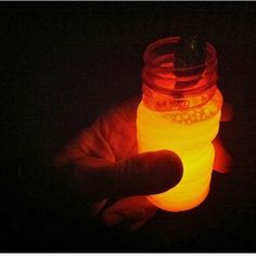 Break open a glow stick and pour it into bubble solution. Bam! Glow in the dark bubbles.