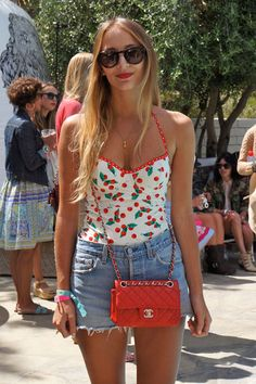 34 of 84  Harley Viera-Newton wears a Juicy Couture swimsuit, a Chanel bag, and Prada sunglasses